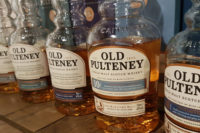 A row of Old Pulteney Scottish whisky bottles