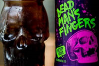A bottle of Dead Man's Fingers CBD-infused Hemp Rum with a rum cocktail